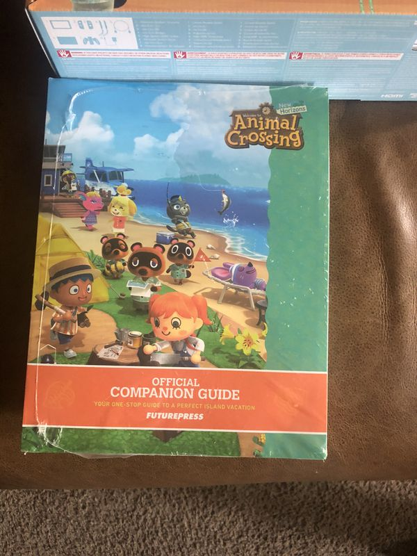 Nintendo switch Animal Crossing edition with official companion guide. (Brand New)