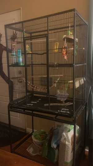Large and small bird cage with accessories for Sale in Denver, CO