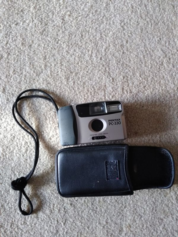 Pentax PC 330 camera(with leather case and unused film roll)