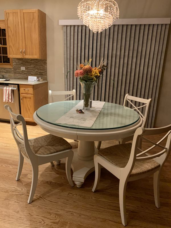 William Sonoma solid wood kitchen table with leaf which makes it oval