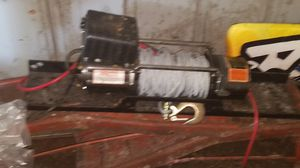 #12,000 electric winch with mounting channel and contol for Sale in Eustis, FL