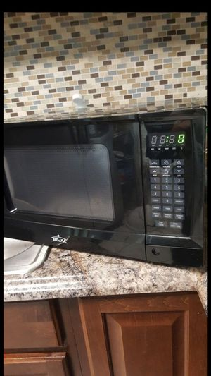 Rival microwave 1350 watts 0.9cu ft for Sale in Tampa, FL