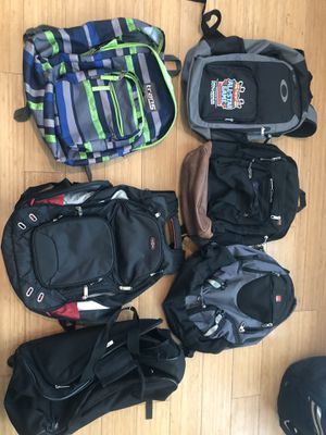 5 great condition backpacks w laptop pouches (Oakley, Jansport and Swiss) plus rolling bag for Sale in Monrovia, CA