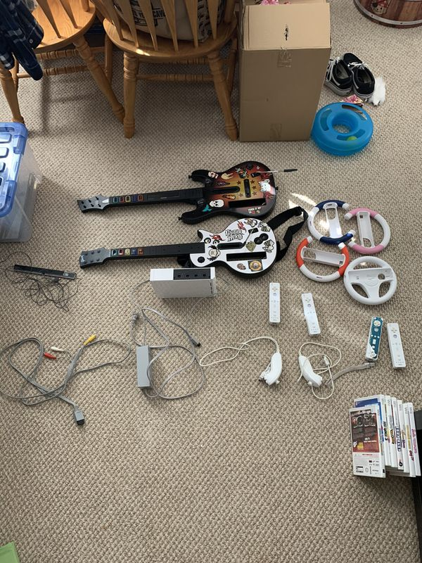Wii + Accessories and games