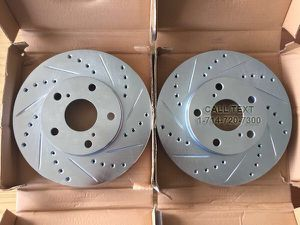 NEW DRILLED AND SLOTTED BRAKE ROTORS FOR ALL MAKES & MODELS for Sale in Garden Grove, CA
