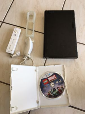 Nintendo Wii U Console Only (No cords), 1 remote, 1 silicone remote cover, 1 nunchuck remote, 1 Game for Sale in Oakland Park, FL