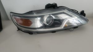 10 12 ford taurus halogen headlight for Sale in Austin, TX