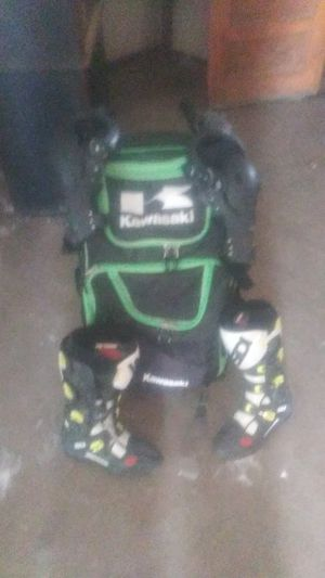 Kawasaki knee pads and riding boots for Sale in Perris, CA