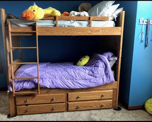 Solid oak captain bunk beds. Can be used as two twin beds also. Custom made for Sale in Fort Wayne, IN