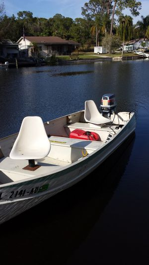 Nice aluminum boat with motor runs excellent With trailer firm on price for Sale in Tarpon Springs, FL