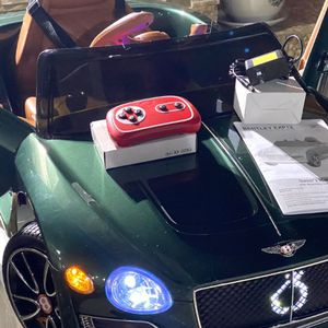 BRAND NEW Green Bently EXP12 12volt REMOTE CONTROL MODEL ELECTRIC KID RIDE ON CAR POWER WHEELS for Sale in Boston, MA
