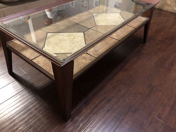 Glass (removable) top coffee table with metal frame.