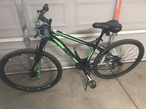 Mountain bike front suspension, disc brakes medium frame excel cond brand new thorn proof inner tubes for Sale in Peoria, AZ