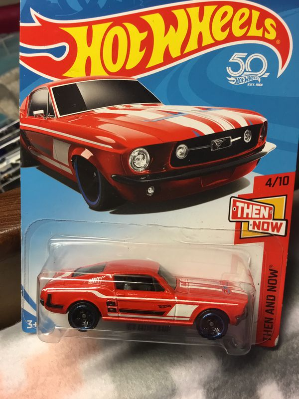 HOT RED FORD MUSTANG HOTWHEEL WITH BLUE RIMS