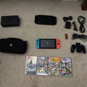 Nintendo switch neon joy cons comes with 4 games, 2 cases, 8bitdo and 128gb micro sd chip for Sale in Monroe, WA