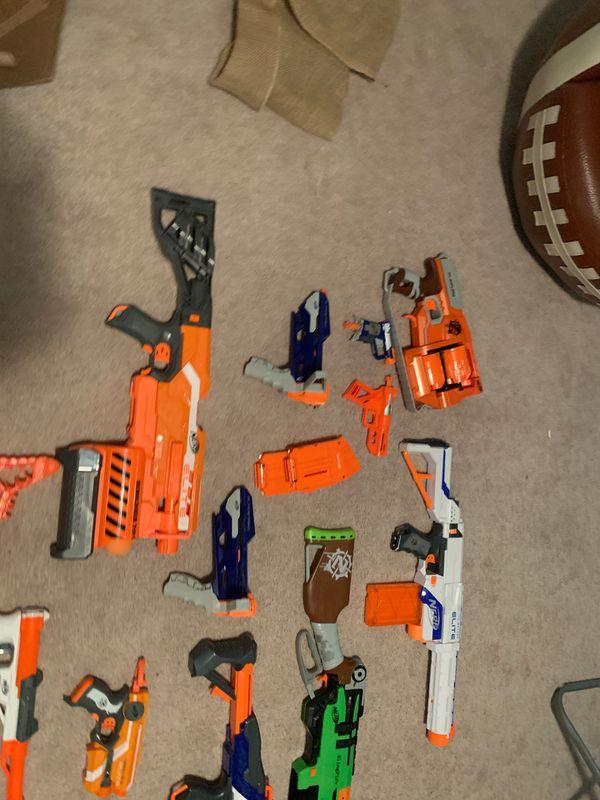 12 nerf guns with 3 cartridges