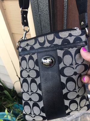 Small coach black purse for Sale in Houston, TX