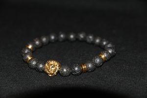 Lion Head Helmet Bracelet Gold/Black for Sale in Burbank, CA