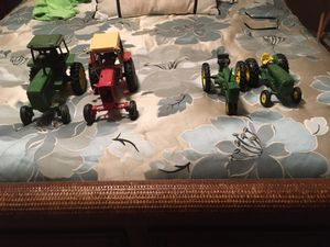 (4) John Deer cat iron tractor toys for Sale in Houston, TX