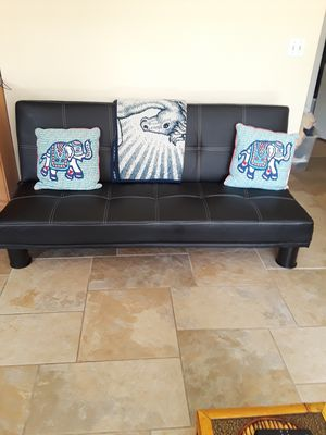 Black leather futon new great condition. Reduced price for Sale in Winter Springs, FL
