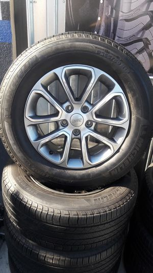 18 inch jeep Cherokee wheels with Michelin tires $600 all four for Sale in Bakersfield, CA