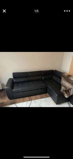 Sleeper sectional, comes with ottoman with storage for Sale in Boston,  MA