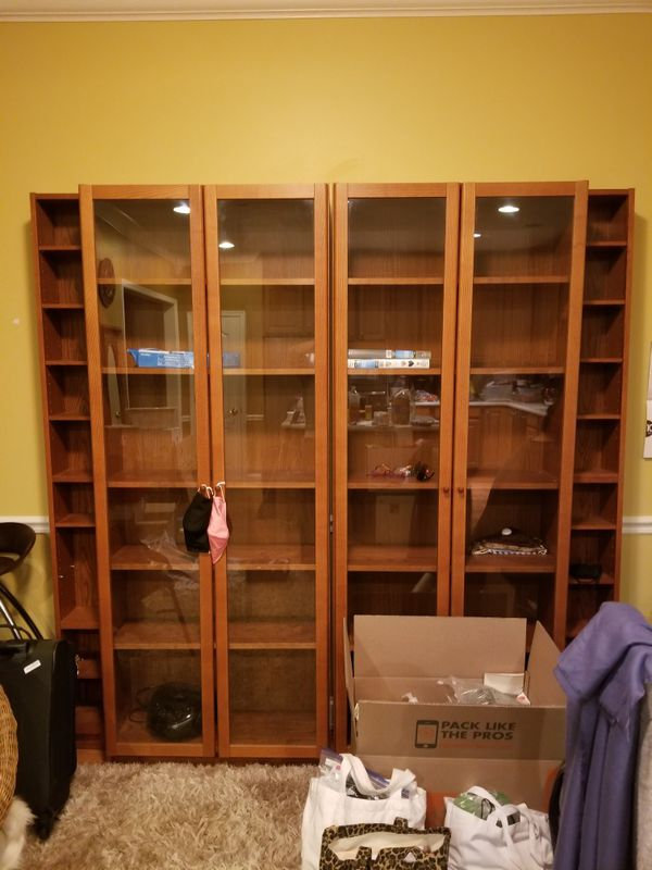 Glass book case with door