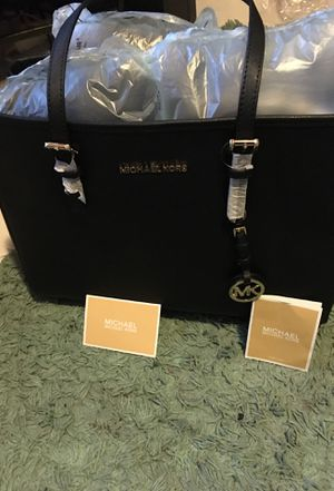 Michael Kors jet set travel black leather lg ew leather for Sale in Frederick, MD