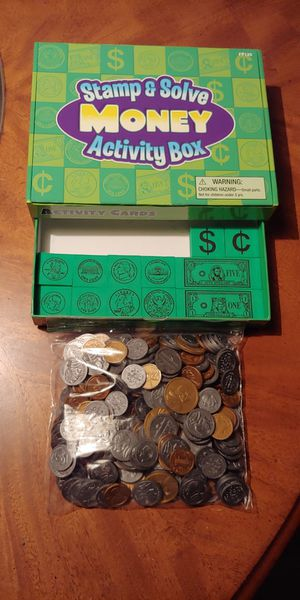 Stamp and solve money activity box and bag of plastic coins for Sale in Grand Prairie, TX