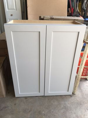 Light gray upper 2 door wall cabinet for Sale in Clermont, FL