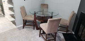 Glass dinner table 4 chairs with covers for Sale in Woodbridge, VA
