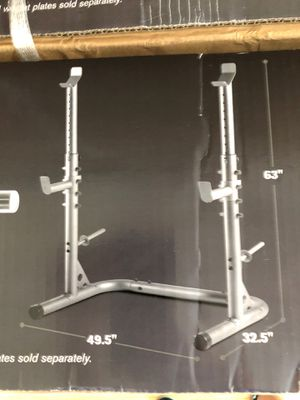 Weider XRS 20 Olympic Squat Rack with Adjustable Saftey Spotters and Integrated Weight Plate Storage for Sale in North Miami, FL