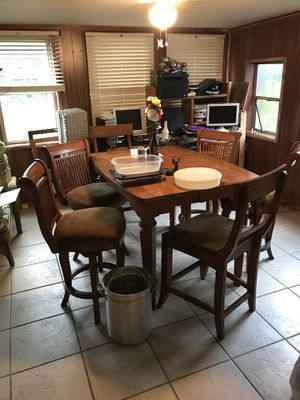 All wood table with center section n 6 high chairs cost $2000 when bought for Sale in Frostproof, FL