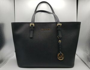 NEW MICHAEL KORS JET SET TRAVEL TOP ZIP TOTE BLACK SAFFIANO LEATHER BAG for Sale in Fresno, CA