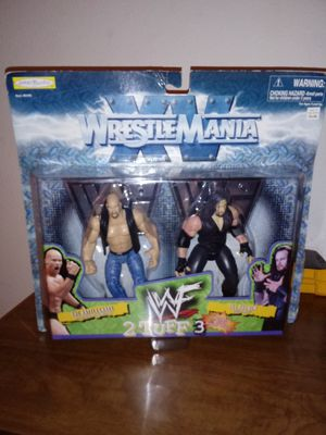 Collectable WWF Wrestle Mania Stone Cold Steve Austin and the Phenom Undertaker action figures! for Sale in Stockton, CA