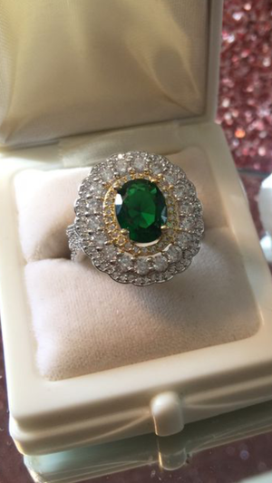 Oval shaped rich green lab Emerald on stamped 925 sterling silver band size 7 for Sale in Brecksville, OH