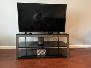 Nice TV table!! Glass and metal that looks like wood. for Sale in Houston, TX