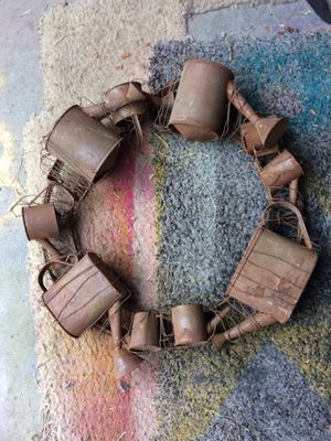 Old antique door wreath made of all antique creamer in little cans. for Sale in Carroll, OH