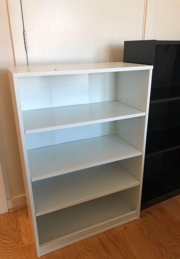 IKEA black bookshelves and white book shelf