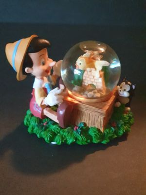 Disney Pinocchio musical snow globe with Cleo and Figaro for Sale in Hialeah, FL