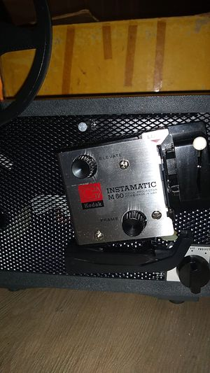 Kodak Instamatic M50 Movie Projector and a 40x40 Kodak Projector Screen for Sale in Charlotte, NC