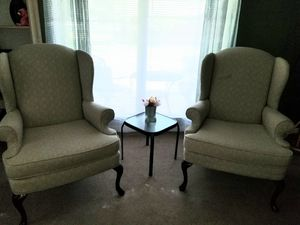 Set of 2 designer wingback chairs gorgeous fabric and detailed wooden legs for Sale in Brentwood, TN