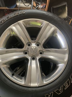 Ram sport 1500 factory rims with tires for Sale in Homestead, PA