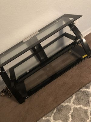 Glass tv stand holds up to 65 inches for Sale in Nashville, TN