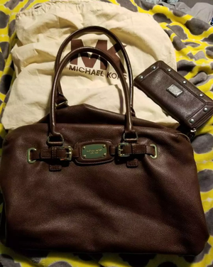 ...TREAT YOURSELF..Michael Kors Weekender bag with matching wallet read below for Sale in Austin, TX