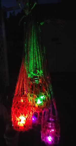 Mason jar lanterns with macrame hangers and color changing lughts for Sale in Acampo, CA