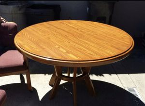 Solid oak kitchen table with four rolling chairs for Sale in Beaverton, OR