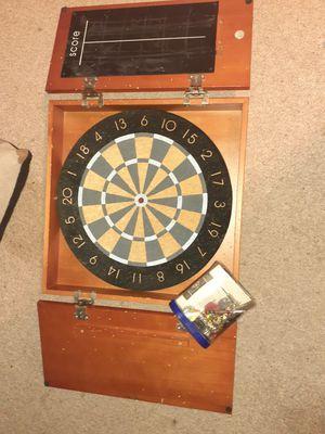Dartboard in cabinet for Sale in Marietta, GA