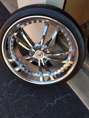 tires and rim stag look and with lug nuts these rims and tires are in very good condition and is solid Chrome for Sale in BVL, FL