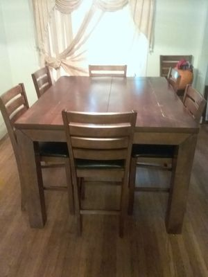 SHINY SOLID WOOD TABLE FOR 6 OR 8 WITH 7 CHAIRS for Sale in San Leandro, CA